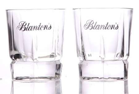 Round heavy glasses with 'Blantons' written on it