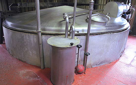 A big stainless steel tun with an open manhole