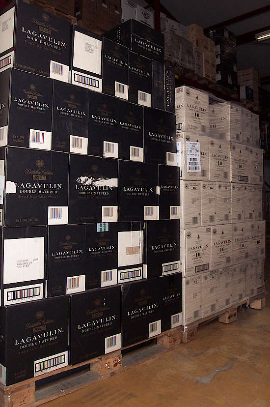 left pallet is filled with the dark cases of Lagavulin distillers edition, right white cases of Lagavulin 16