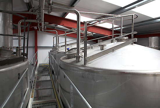A stainless steel tun in a hall