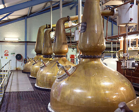 The pot stills inside the distillery.
