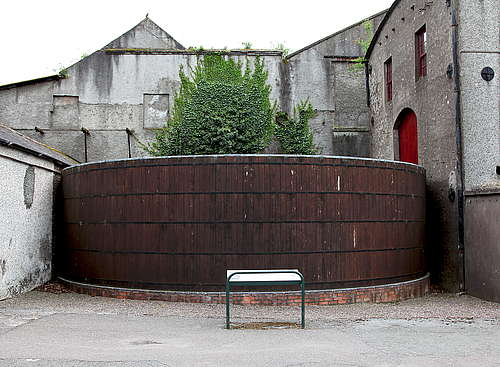 A big wide wooden tun in the yard of the Midelton distillery