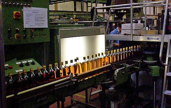 bottles in front of a bright white screen at Chivas bottling