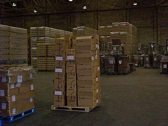 A pallet with boxes on it in a big hall with a lot of pallets