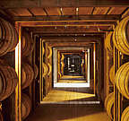 Read about how Bourbon Whiskey is stored into the warehouse. Learn about the layers, tradition of barrel rotation, the temperature and the effects of the maturation.