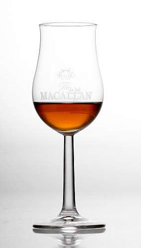whisky stem glass that widens at the top