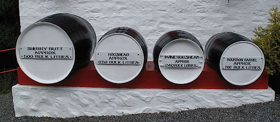 Different casks in front of the Edradour distillery