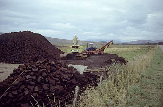 An excavator cutting peat